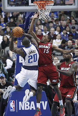 Miami Heat's Mario Chalmers (15) and LeBron James (6) defend Dallas Mavericks guard Dominique Jones (20) during the second half of an NBA basketball game in Dallas, Sunday, Dec. 25, 2011. The Heat won 105-94.