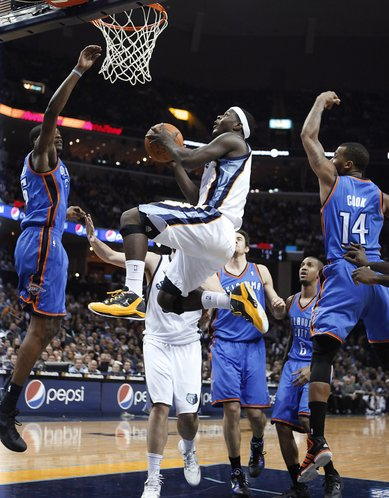 Memphis Grizzlies guard Josh Selby goes to the basket between Oklahoma City Thunder defenders Kevin Durant, left, and Daequan Cook (14) in the second half of an NBA basketball game Wednesday, Dec. 28, 2011, in Memphis, Tenn. The Thunder won 98-95.