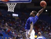 Kansas forward Thomas Robinson pulls back for a pregame dunk prior to tipoff against Howard on Thursday, Dec. 29, 2011 at Allen Fieldhouse.