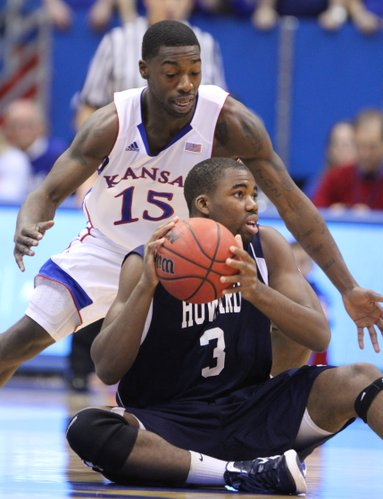 Kansas guard Elijah Johnson hovers over Howard guard Prince Okoroh during the first half Thursday, Dec. 29, 2011 at Allen Fieldhouse.