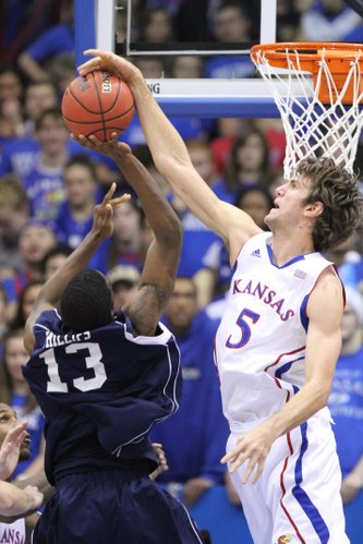 Kansas center Jeff Withey stuffs a shot by Howard forward Mike Phillips during the first half Thursday, Dec. 29, 2011 at Allen Fieldhouse.
