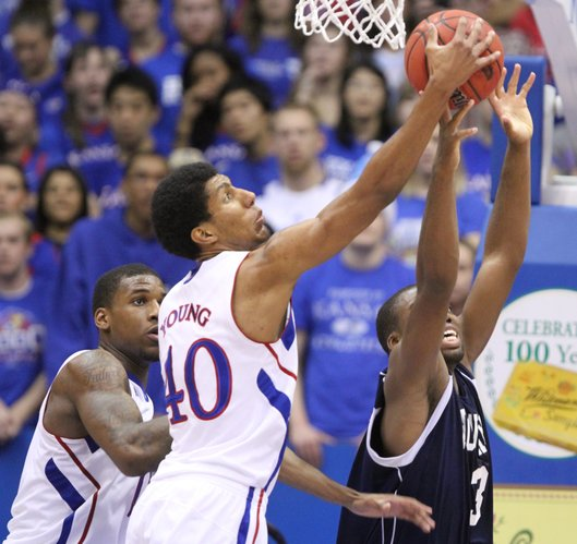 Kansas forward Kevin Young fights for a rebound with Howard guard Prince Okoroh during the first half on Thursday, Dec. 29, 2011 at Allen Fieldhouse.