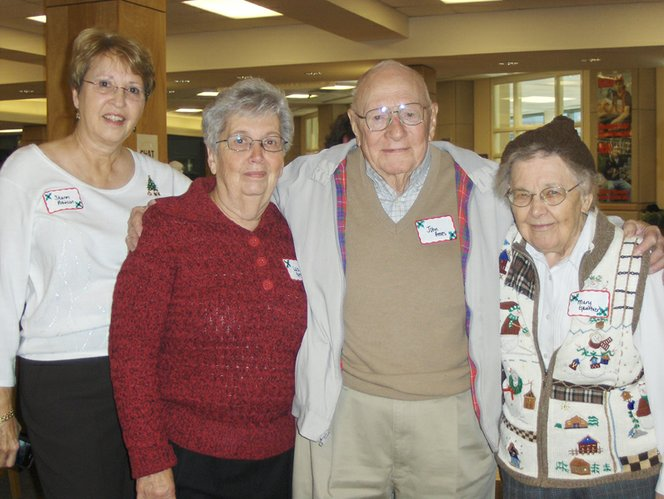The Retired Lawrence High School Teachers had their annual Christmas luncheon at the LHS library Dec. 8. Joining in on the holiday fun were retired business teachers, from left, Sharon Robinson, Louis Groh, John Ames and Mary Gauthier. Becky Torneden-Johnson, Pamela Fangohr and Martha Oldham (not pictured) helped in the planning of the luncheon. Oldham submitted the photo.