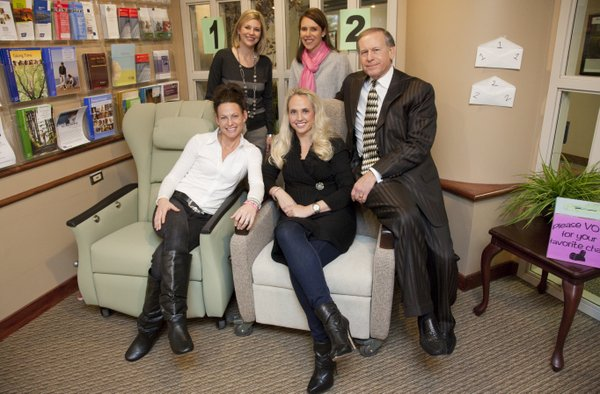 Clockwise from right are Lawrence businessman Miles Schnaer, Aimee Jackson, Kelli Alldredge, Lisa Prosser and Kristin Pearson. They helped raise $100,000 to make Lawrence resident Jamie Pursley's dying wish come true and that was to upgrade the 15 infusion rooms at Lawrence Memorial Hospital's Oncology Center where she received treatment. On Friday, Dec. 30, 2011, they visited the oncology center's waiting room to check out a couple of infusion chairs. They are having staff, patients and visitors vote on their favorite chair and the winner will replace the old ones. The renovation is expected to be complete near March 29, which would be the first anniversary of their friend's death.