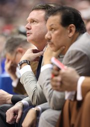 Kansas head coach Bill Self adjusts his tie as he watches from the bench next to assistant Kurtis Townsend during the second half on Saturday, Dec. 31, 2011 at Allen Fieldhouse.