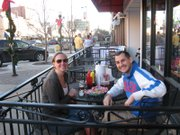 Angela Watts (right) and Paul Nagy enjoy the 60-plus-degree New Year's Eve weather by eating outside Jefferson's, 743 Mass. St.
