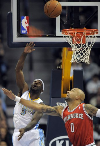 Denver Nuggets guard Ty Lawson (3) shoots a basket against Milwaukee Bucks forward Drew Gooden (0) during the first quarter of an NBA basketball game in Denver, Monday, Jan. 2, 2012.