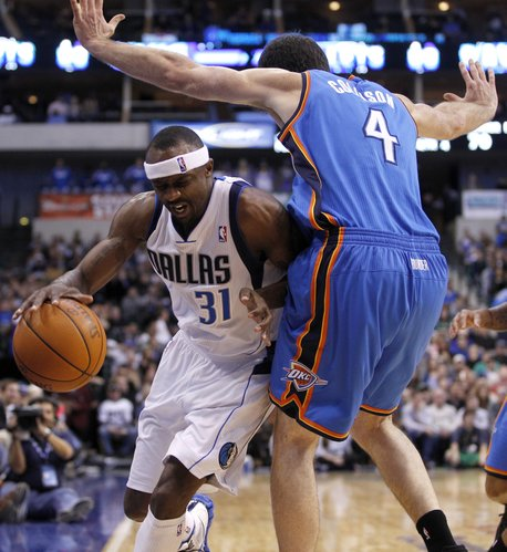 Dallas Mavericks guard Jason Terry (31) is knocked out of bounds by Oklahoma City Thunder forward Nick Collison (4) during the second half of an NBA basketball game, Monday, Jan. 2, 2012, in Dallas. Dallas won 100-87.