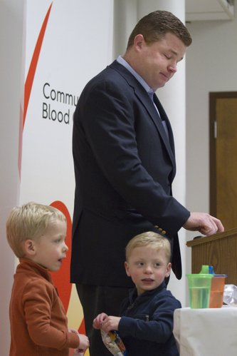 Thomas Charles, of Kansas City, Mo., pauses to compose himself while he was thanking donors who had given blood that helped treat his 4-year-old son Joseph, right.  At  left, is Joseph's twin brother Patrick.