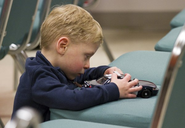 Joseph Charles, 4, plays with a toy police car that was given to him by David Mellott, one of his blood donors.