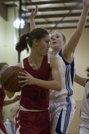 Veritas' Ellen Phillips, right, defends Topeka Cornerstone's Morgan Coffmon (20) on Tuesday, Jan. 3, 2012 in Eudora.