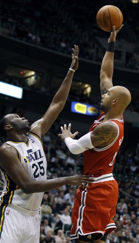 Milwaukee Bucks' Drew Gooden, right, hooks a shot over Utah Jazz's Al Jefferson during the first half of an NBA basketball game in Salt Lake City, Tuesday, Jan. 3, 2012.