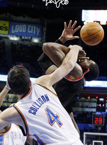 Portland Trail Blazers forward LaMarcus Aldridge, right, is fouled by Oklahoma City Thunder center Nick Collison (4) in the fourth quarter of an NBA basketball game in Oklahoma City, Tuesday, Jan. 3, 2012. Portland won 103-93.
