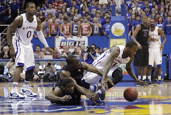 Tyshawn Taylor, (10) left, loses the handle on a ball against Kansas State in the first half Wednesday, Jan. 4, 2012 at Allen Fieldhouse.
