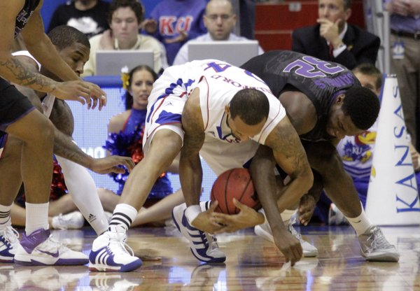 Kansas guard Travis Releford and Kansas State&#39;s Jamar Samuels battle for a loose ball Wednesday, Jan. 4, 2012 at Allen Fieldhouse.