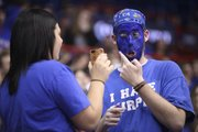 Kansas University sophomore Matt Apuzzo, Boston, applies face paint with the help of sophomore Hannah Cliche, Zimmerman, Minn., and her iPhone before tip-off against Kansas State on Wednesday, Jan. 4, 2012 at Allen Fieldhouse.
