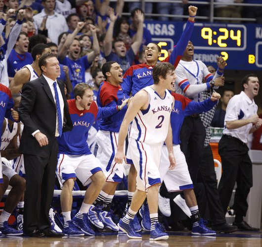 Kansas guard Conner Teahan and the Jayhawk bench go wild following a Jayhawk bucket during a run against Kansas State in the second half on Wednesday, Jan. 4, 2012 at Allen Fieldhouse.