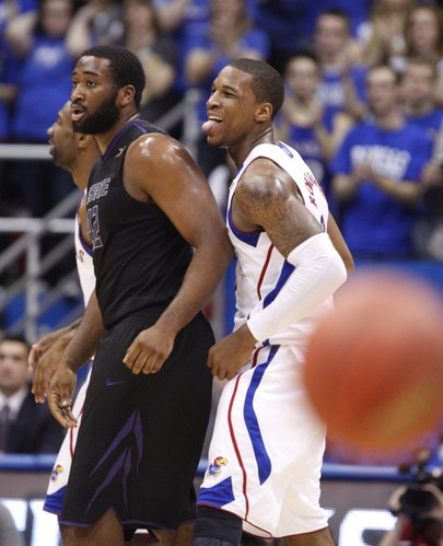 Kansas forward Thomas Robinson wags his tongue with delight behind Kansas State forward Thomas Gipson during a Jayhawk run in the first half on Wednesday, Jan. 4, 2012 at Allen Fieldhouse.