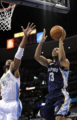 FILE - In this Dec. 5, 2010, file photo, Memphis Grizzlies guard Xavier Henry (13) shoots against Denver Nuggets center Nene (31) from Brazil during an NBA basketball game in Denver. A person familiar with the deal says Philadelphia, Memphis and New Orleans have agreed on a multi-player trade. The 76ers are sending Marreese Speights to Memphis, the Grizzlies will move Xavier Henry to New Orleans and the Grizzlies and Hornets each will send a second-round draft pick to Philadelphia, the person told The Associated Press Wednesday, Jan. 4, 2012, on condition of anonymity because the deal had not been announced.