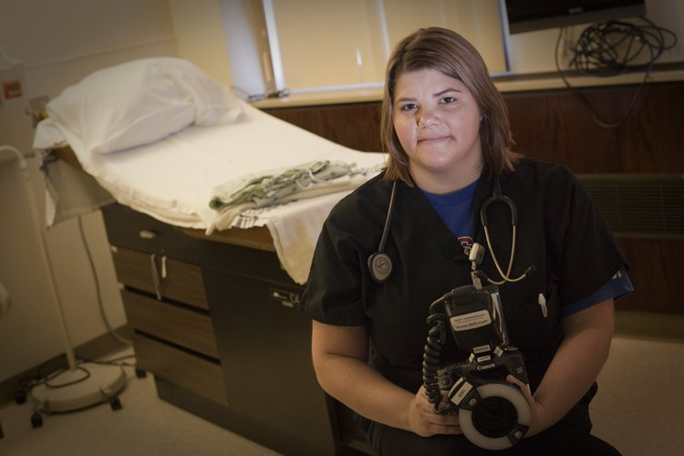 Jessie Fazel, coordinator of Lawrence Memorial Hospital's Sexual Assault Nurse Examiner program, holds a high-resolution digital camera that is used to collect evidence on Dec. 30, 2011. The hospital began using the camera in June 2010. The camera is just one of several improvements that the hospital has made during the past couple of years in its services to sexual assault victims.