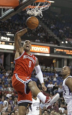 Milwaukee Bucks center Drew Gooden dunks in front of Sacramento Kings forward Chuck Hayes during the first quarter of an NBA basketball game in Sacramento, Calif., Thursday, Jan. 5, 2012.
