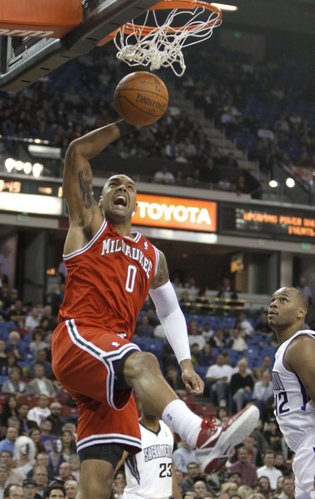 Milwaukee Bucks center Drew Gooden dunks in front of Sacramento Kings forward Chuck Hayes during the first quarter of an NBA basketball game in Sacramento, Calif., Thursday, Jan. 5, 2012.