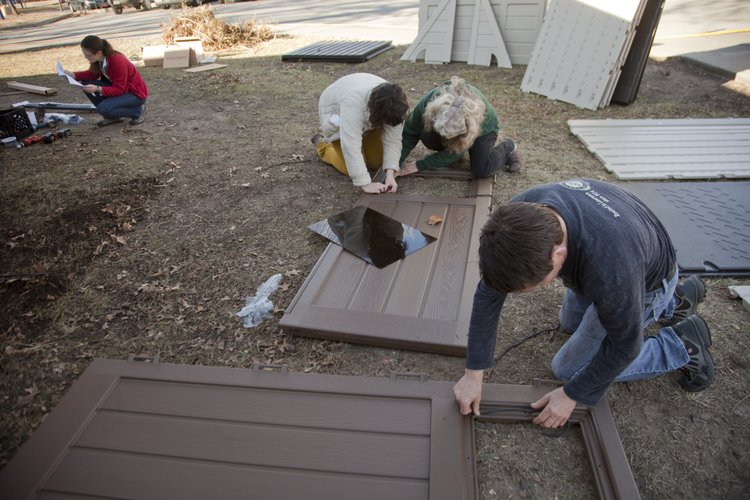 From left, Community Mercantile employees Jenny Buller, lead class host, Lily Siebert, education outreach assistant, Nancy O'Connor, director of education and outreach, and Buck Shryock, facilities assistant, assemble a garden storage shed at Sunset Hill school Friday, Jan. 6, 2011. A garden was planted last spring as part of the Growing Food, Growing Health project, which is a partnership between the Community Mercantile Education Foundation and three schools. Mainstreet Credit Union donated $700 for the shed.