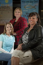 Dot Fernandez, left and Cindy Manske, center, run Freedom Foundation Ministries, which mentors female prisoners in Topeka. Diana Jurik, right, is an ex-convict who has gone though their program and continues to be mentored by Fernandez.
