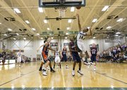 Free State guard Cameron Dabney (14) shoots over Olathe East's Caelan Neal (2) on Friday, Jan. 6, 2012, at FSHS.