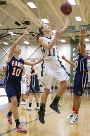 Free State's Kennedy Kirkpatrick (11) drives past Olathe East's Regan Stone (10) on Friday, Jan. 6, 2012, at FSHS.