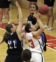 Lawrence High's Kionna Coleman (33) fights for the ball against Olathe Northwest on Friday, Jan. 6, 2012, at LHS.