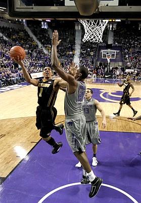 Missouri guard Phil (Flip) Pressey (1) puts up a shot under pressure from Kansas State center Jordan Henriquez (21) during the first half Saturday, Jan. 7, 2012, in Manhattan, Kan.