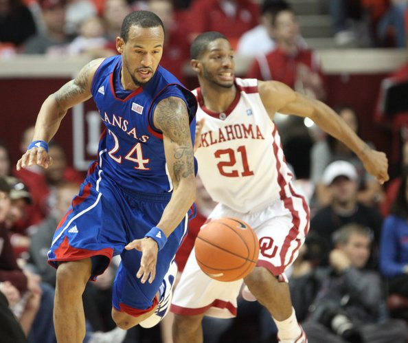 Kansas guard Travis Releford comes away with a steal from Oklahoma guard Cameron Clark during the first half Saturday, Jan. 7, 2012, at Lloyd Noble Center.
