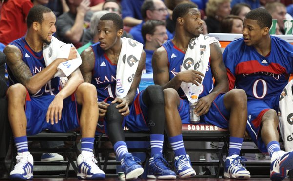 Kansas starters Travis Releford, left, Tyshawn Taylor, Elijah Johnson and Thomas Robinson get a break to chat on the bench late in the game against Oklahoma on Saturday, Jan. 7, 2012, at Lloyd Noble Center.