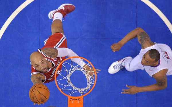 Milwaukee Bucks forward Drew Gooden, left, puts up a shot as Los Angeles Clippers forward Caron Butler defends during the second half of their NBA basketball game, Saturday, Jan. 7, 2012, in Los Angeles. The Clippers won 92-86.