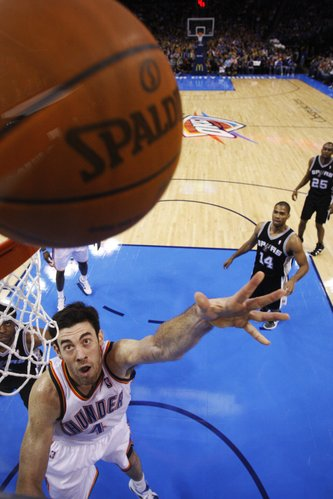 Oklahoma City Thunder center Nick Collison shoots against the San Antonio Spurs in the fourth quarter of an NBA basketball game in Oklahoma City, Sunday, Jan. 8, 2012. Oklahoma City won 108-96.