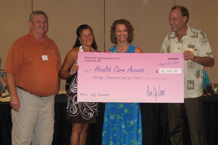 Lawrence River City Cosmopolitan Club members Gary Bartlett, left, and Greg Hird, far right, present a $30,000 donation to Kim Johnson, second from left, and Nikki White, Health Care Access Clinic representatives, during the club's inaugural dinner. The donation was made possible from proceeds from the club's 2011 KU Credit Union Cosmopolitan Diabetes Golf Classic fundraiser.