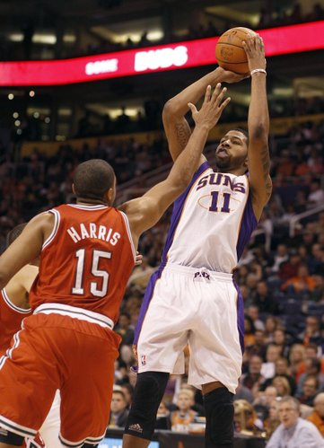 Phoenix Suns' Markieff Morris, right, against Milwaukee Bucks' Tobias Harris, left, in an NBA basketball game Sunday, Jan. 8, 2012, in Phoenix.