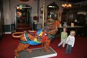 A carousel lion at the Patee House Museum in St. Joseph, Mo., draws the attention of young visitors.