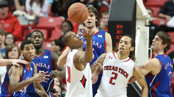 The Jayhawks and Red Raiders chase a rebound during the first half Wednesday, Jan. 11, 2012, at United Spirit Arena.