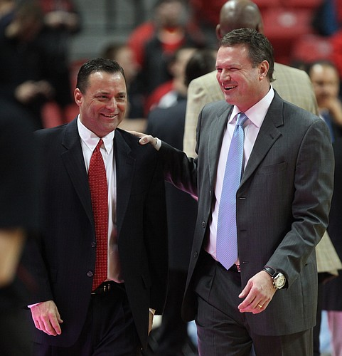 Kansas head coach Bill Self, right, laughs with Texas Tech head coach Billy Gillispie, who is Self's former assistant, prior to tipoff on Wednesday, Jan. 11, 2012, at United Spirit Arena.