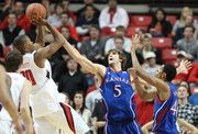 Kansas center Jeff Withey defends a shot by Texas Tech forward Jaye Crockett during the first half Wednesday, Jan. 11, 2012, at United Spirit Arena.