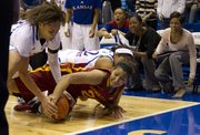 Kansas forward Tania Jackson, left, and Iowa State forward Brynn Williamson fight for a loose ball Wednesday, Jan. 11, 2012, at Allen Fieldhouse.