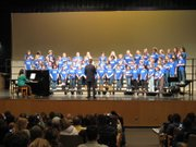 Students from Sunflower Elementary School's choir, lead by music teacher Paul Gipson, perform at the district's annual Martin Luther King Day celebration Jan. 12, 2012 at Free State High School.