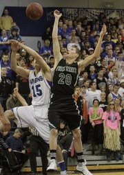 Free State's Tyler Self (20) reaches for a rebound during action against the Ravens of Olathe Northwest Friday, Jan. 13, 2012, at Northwest.