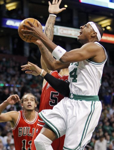 Boston Celtics' Paul Pierce, right, drives to the basket against Chicago Bulls' Carlos Boozer (5) as Chicago Bulls' Joakim Noah (13) looks on in the first quarter of an NBA basketball game in Boston, Friday, Jan. 13, 2012.