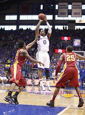 Kansas forward Thomas Robinson puts up a jumper between Iowa State defenders Anthony Booker, left, and Tyrus McGee during the first half on Saturday, Jan. 14, 2012 at Allen Fieldhouse.