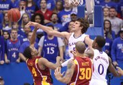 Kansas center Jeff Withey rejects a shot by Iowa State guard Chris Allen during the first half on Saturday, Jan. 14, 2012 at Allen Fieldhouse.