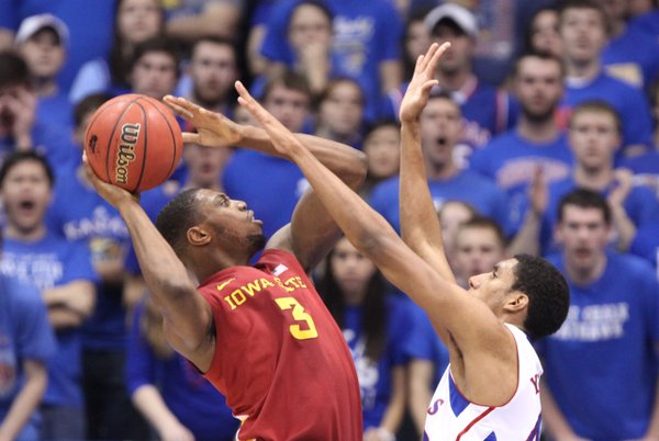 Kansas forward Kevin Young defends against a shot from Iowa State forward Melvin Ejim during the second half on Saturday, Jan. 14, 2012 at Allen Fieldhouse.