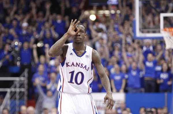 "Kansas guard Tyshawn Taylor signals ""three"" after a bucket against Iowa State during the second half on Saturday, Jan. 14, 2012 at Allen Fieldhouse."